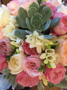 Closeup of garden rose centerpiece.